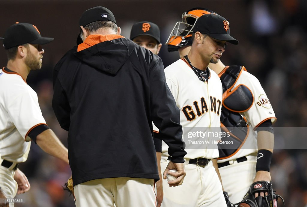 Manager <a gi-track='captionPersonalityLinkClicked' href=/galleries/search?phrase=Bruce+Bochy&family=editorial&specificpeople=220291 ng-click='$event.stopPropagation()'>Bruce Bochy</a> #15 of the San Francisco Giants takes the ball from pitcher <a gi-track='captionPersonalityLinkClicked' href=/galleries/search?phrase=Ryan+Vogelsong&family=editorial&specificpeople=670011 ng-click='$event.stopPropagation()'>Ryan Vogelsong</a> #32 taking him out of the game in the top of the seventh inning against the Los Angeles Dodgers at AT&T Park on April 16, 2014 in San Francisco, California.