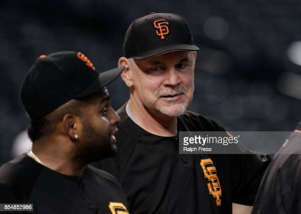 Manager Bruce Bochy of the San Francisco Giants talks with Pablo Sandoval of the Giants before the start of a MLB game against the Arizona...