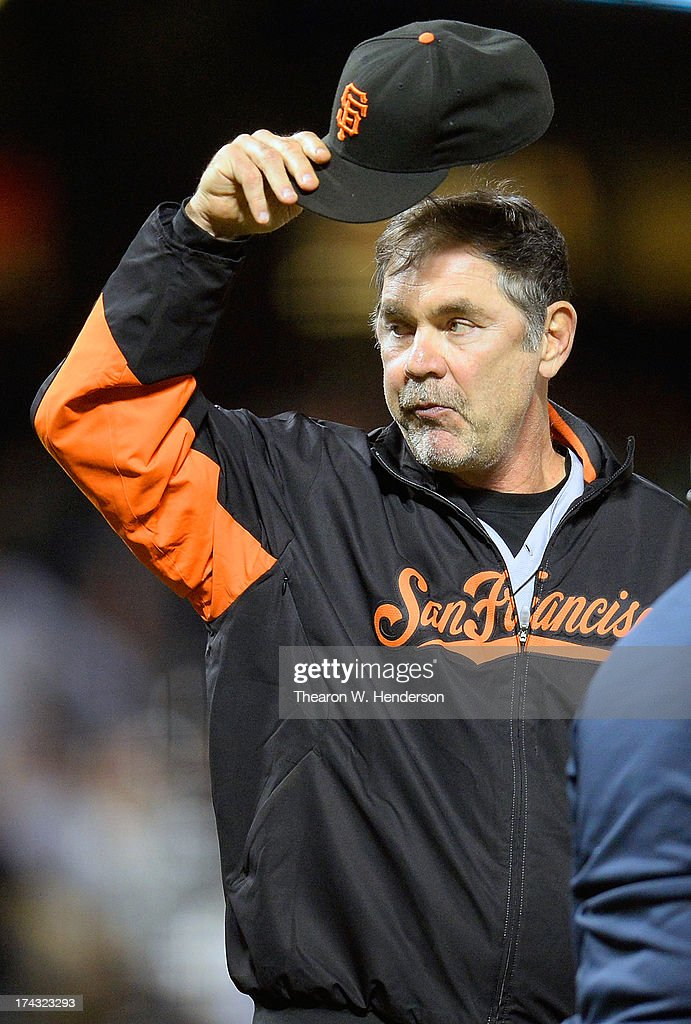 Manager Bruce Bochy #15 of the San Francisco Giants tips his cap to the fans after the Giants defeated the Cincinnati Reds 5-3 in game two of a double header at AT&T Park on July 23, 2013 in San Francisco, California. The victory was Bochy's 1500th as a manager.
