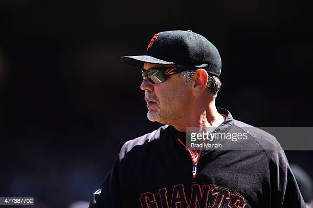 Manager Bruce Bochy of the San Francisco Giants walks off the field after being ejected from the game against the Seattle Mariners at ATT Park on...