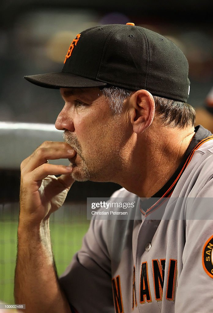 Manager Bruce Bochy of the San Francisco Giants watches from the dugout during the Major League Baseball game against the Arizona Diamondbacks at Chase Field on May 19, 2010 in Phoenix, Arizona.