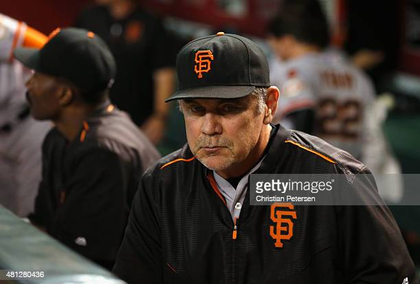 Manager Bruce Bochy of the San Francisco Giants watches from the dugout during the MLB game against the Arizona Diamondbacks at Chase Field on July...