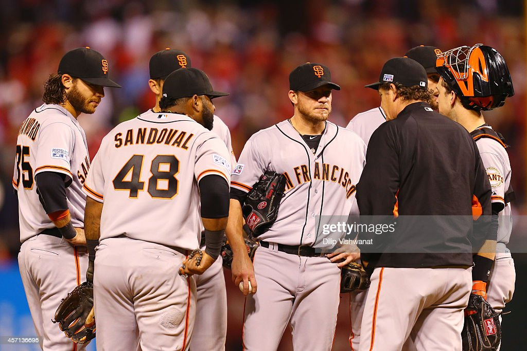 Manager Bruce Bochy #15 talks to Jake Peavy #22 of the San Francisco Giants on the mound in the fifth inning against the St. Louis Cardinals during Game Two of the National League Championship Series at Busch Stadium on October 12, 2014 in St Louis, Missouri.