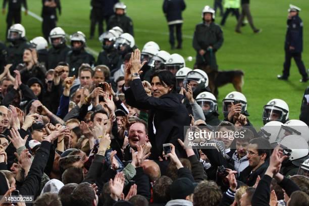 Manager Bruno Huebner of Frankfurt celebrates with supporters after the Second Bundesliga match between Alemannia Aachen and Eintracht Frankfurt at...