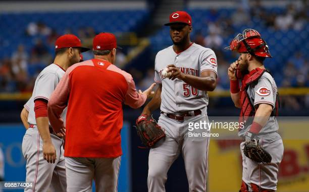 Manager Bryan Price of the Cincinnati Reds takes pitcher Amir Garrett off the mound during the fourth inning of a game against the Tampa Bay Rays on...