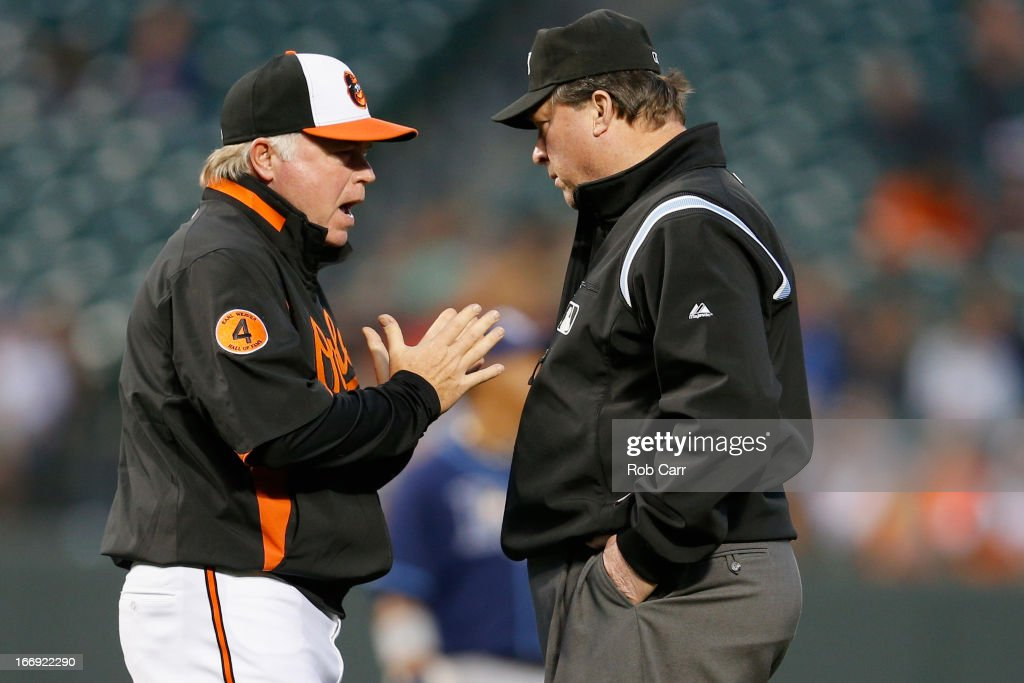 Manager Buck Showalter of the Baltimore Orioles argues a call with second base umpire Gerry Davis during the second inning of the Orioles game against the Tampa Bay Rays at Oriole Park at Camden Yards on April 18, 2013 in Baltimore, Maryland.