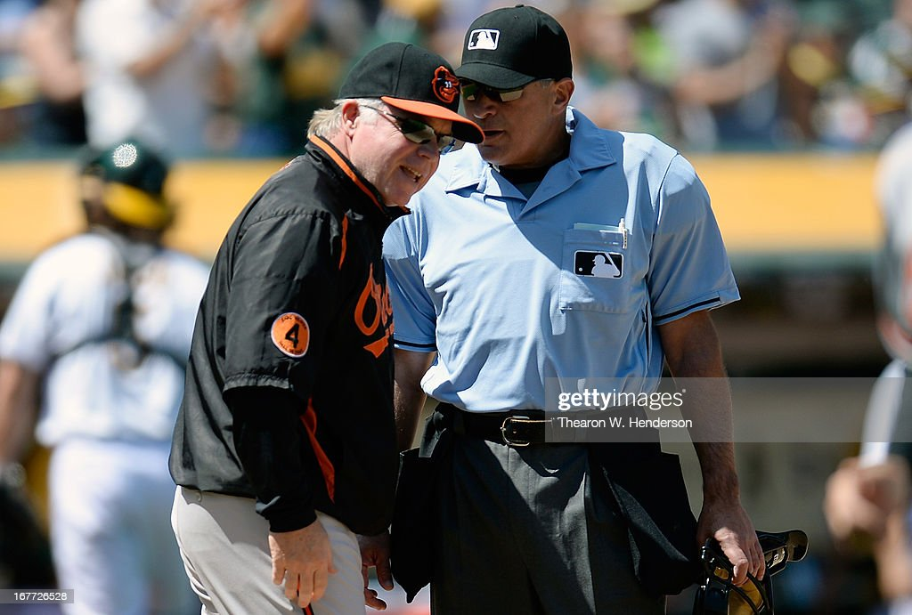 Manager Buck Showalter #16 of the Baltimore Orioles argues an out call at home plate with umpire John Hirschbeck #17 against the Oakland Athletics in the fifth inning at O.co Coliseum on April 28, 2013 in Oakland, California. Hirschbeck called Manny Machado out attempting to score from first base on a double by Adam Jones.