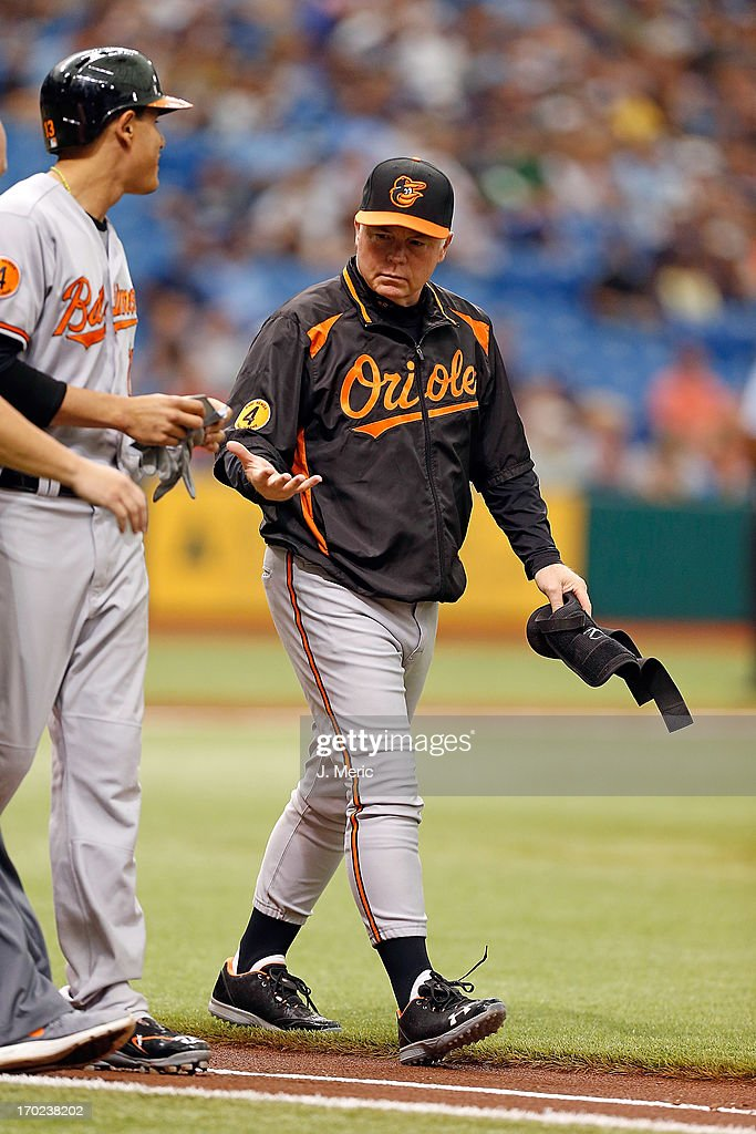 Manager <a gi-track='captionPersonalityLinkClicked' href=/galleries/search?phrase=Buck+Showalter&family=editorial&specificpeople=208183 ng-click='$event.stopPropagation()'>Buck Showalter</a> #26 of the Baltimore Orioles checks on <a gi-track='captionPersonalityLinkClicked' href=/galleries/search?phrase=Manny+Machado&family=editorial&specificpeople=5591039 ng-click='$event.stopPropagation()'>Manny Machado</a> in the first inning against the Tampa Bay Rays at Tropicana Field on June 9, 2013 in St. Petersburg, Florida.