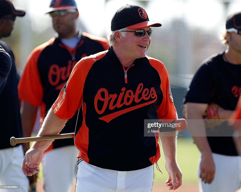 Manager <a gi-track='captionPersonalityLinkClicked' href=/galleries/search?phrase=Buck+Showalter&family=editorial&specificpeople=208183 ng-click='$event.stopPropagation()'>Buck Showalter</a> #26 of the Baltimore Orioles smiles just prior to the start of the Grapefruit League Spring Training Game against the Washington Nationals at Ed Smith Stadium on March 24, 2012 in Sarasota, Florida.