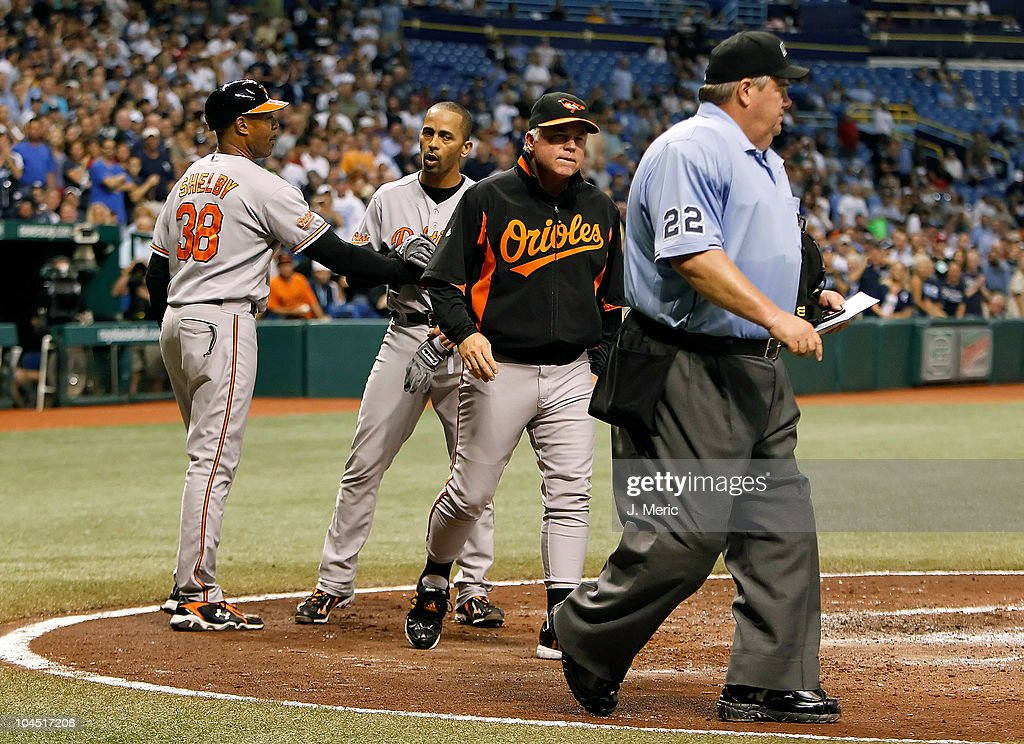 Manager Buck Showalter of the Baltimore Orioles talks with homeplate umpire Joe West after he ejected Julio Lugo against the Tampa Bay Rays during...