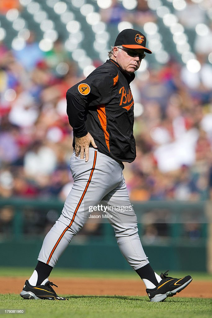 Manager <a gi-track='captionPersonalityLinkClicked' href=/galleries/search?phrase=Buck+Showalter&family=editorial&specificpeople=208183 ng-click='$event.stopPropagation()'>Buck Showalter</a> #26 of the Baltimore Orioles walks off the field after debating a call during the second inning against the Cleveland Indians at Progressive Field on September 2, 2013 in Cleveland, Ohio.