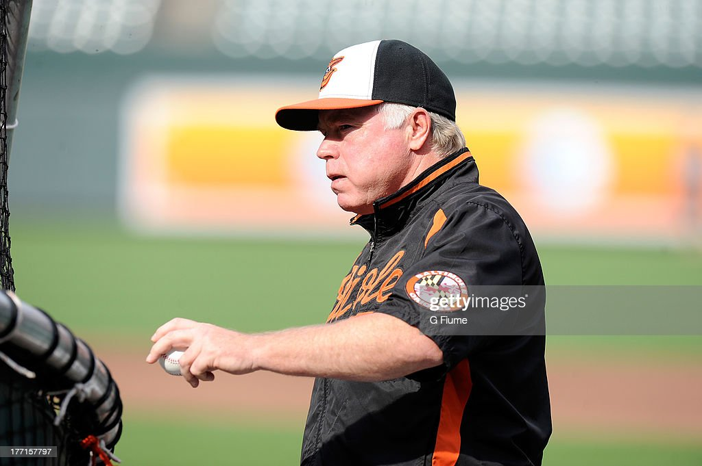 Manager <a gi-track='captionPersonalityLinkClicked' href=/galleries/search?phrase=Buck+Showalter&family=editorial&specificpeople=208183 ng-click='$event.stopPropagation()'>Buck Showalter</a> #26 of the Baltimore Orioles watches batting practice before the game against the Colorado Rockies at Oriole Park at Camden Yards on August 16, 2013 in Baltimore, Maryland.