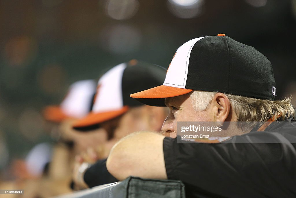 Manager <a gi-track='captionPersonalityLinkClicked' href=/galleries/search?phrase=Buck+Showalter&family=editorial&specificpeople=208183 ng-click='$event.stopPropagation()'>Buck Showalter</a> of the Baltimore Orioles watches from the dugout as his team plays the Cleveland Indians in the eighth inning of their victory at Oriole Park at Camden Yards on June 27, 2013 in Baltimore, Maryland. The Baltimore Orioles won, 7-3.