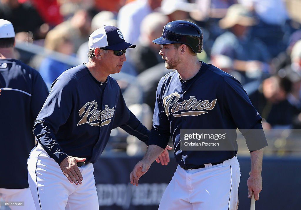 Manager <a gi-track='captionPersonalityLinkClicked' href=/galleries/search?phrase=Bud+Black&family=editorial&specificpeople=167104 ng-click='$event.stopPropagation()'>Bud Black</a> of the San Diego Padres congratulates <a gi-track='captionPersonalityLinkClicked' href=/galleries/search?phrase=Chase+Headley&family=editorial&specificpeople=4353228 ng-click='$event.stopPropagation()'>Chase Headley</a> #7 after he scored a fourth inning run against the Cincinnati Reds during the spring training game at Peoria Stadium on February 26, 2013 in Peoria, Arizona.