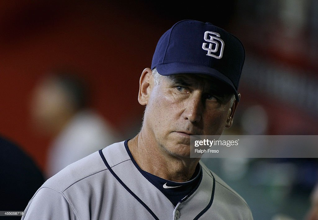 Manager Bud Black of the San Diego Padres looks on from the dugout during the seventh inning of a MLB game against the Arizona Diamondbacks at Chase...