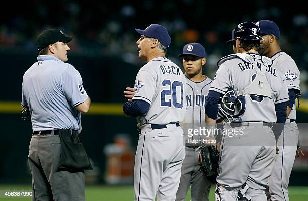 Manager Bud Black of the San Diego Padres makes a point to home plate umpire Dan Bellino during a mound visit in the fourth inning of a MLB game...