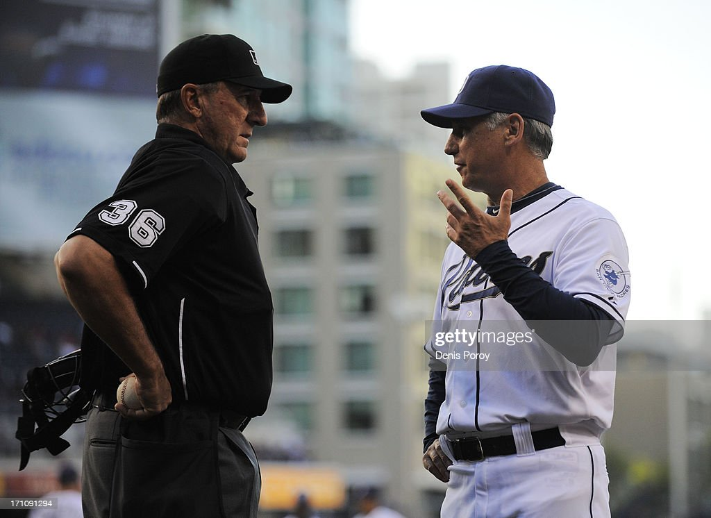 Manager <a gi-track='captionPersonalityLinkClicked' href=/galleries/search?phrase=Bud+Black&family=editorial&specificpeople=167104 ng-click='$event.stopPropagation()'>Bud Black</a> #20 of the San Diego Padres talks with umpire <a gi-track='captionPersonalityLinkClicked' href=/galleries/search?phrase=Tim+McClelland&family=editorial&specificpeople=561877 ng-click='$event.stopPropagation()'>Tim McClelland</a> during the first inning of a baseball game against the Los Angeles Dodgers at Petco Park on June 21, 2013 in San Diego, California.