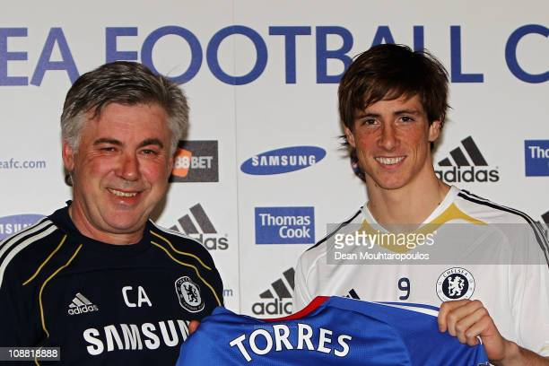 Manager Carlo Ancelotti and Fernando Torres pose for the media at the Chelsea Press Conference on February 4 2011 in Cobham England