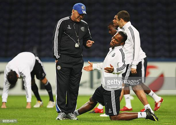 Manager Carlo Ancelotti speaks to Didier Drogba during the Chelsea training session prior to UEFA Champions League Group D match against FC Porto at...