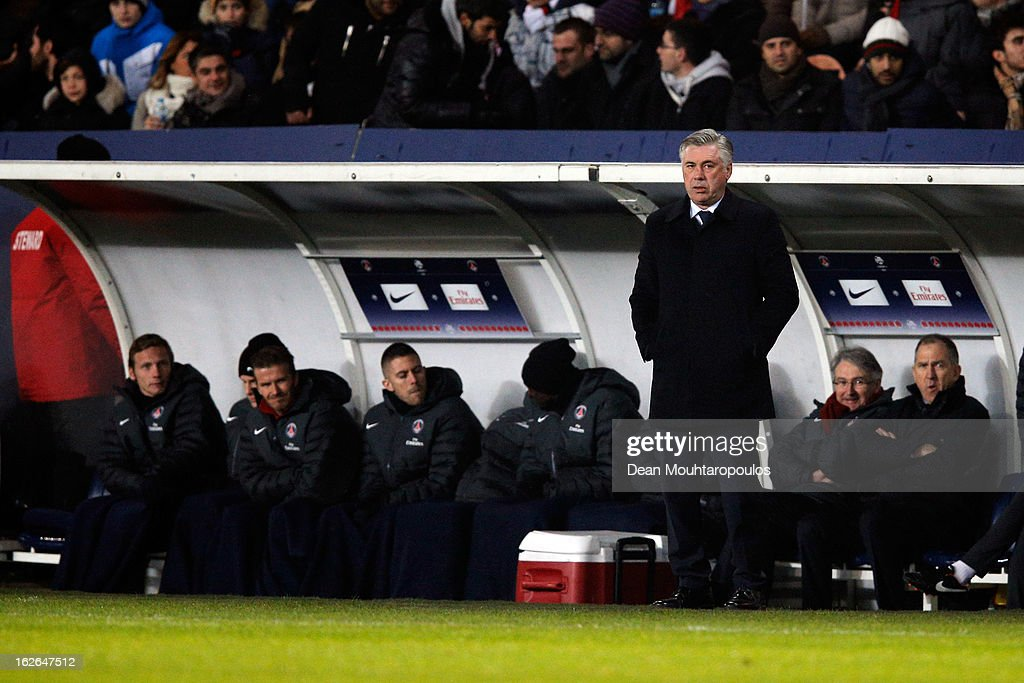 Manager, <a gi-track='captionPersonalityLinkClicked' href=/galleries/search?phrase=Carlo+Ancelotti&family=editorial&specificpeople=226747 ng-click='$event.stopPropagation()'>Carlo Ancelotti</a> stands on the side lines as <a gi-track='captionPersonalityLinkClicked' href=/galleries/search?phrase=David+Beckham&family=editorial&specificpeople=158480 ng-click='$event.stopPropagation()'>David Beckham</a> of PSG is pictured on the bench with his new team mates prior to the Ligue 1 match between Paris Saint-Germain FC and Olympique de Marseille at Parc des Princes on February 24, 2013 in Paris, France.