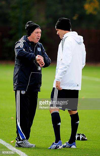 Manager Carlo Ancelotti talks with Michael Ballack during the Chelsea Training session at the Chelsea FC training ground on October 20 2009 in Cobham...
