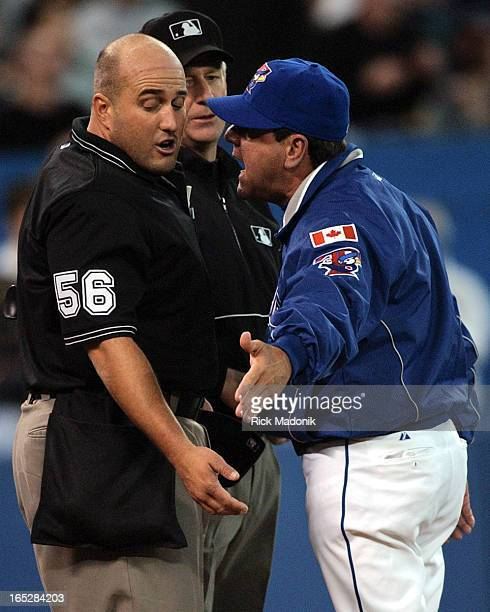 IMAGE 04/08/03 TORONTO ONTARIO Manager Carlos Tosca argues the call on Chris Woodward with homeplate umpire Eric Cooper during Toronto Blue Jays and...