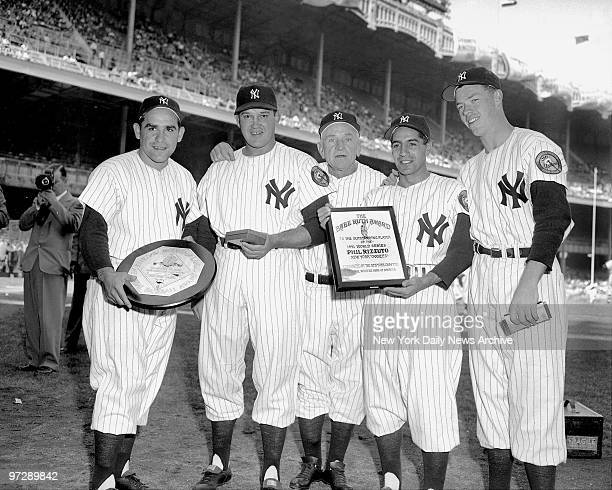 Manager Casey Stengel gets together with some awardwinning members of his World Champion New York Yankees during pregame ceremonies at the Stadium...