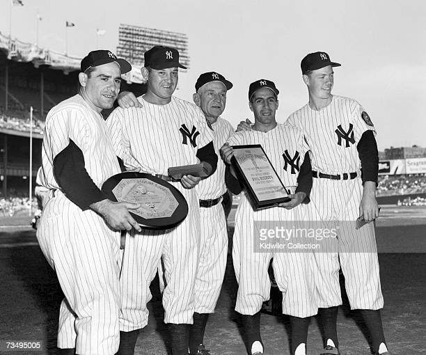 Manager Casey Stengel of the New York Yankees is flanked by his award winners from the 1951 season including catcher Yogi Berra pitcher Allie...