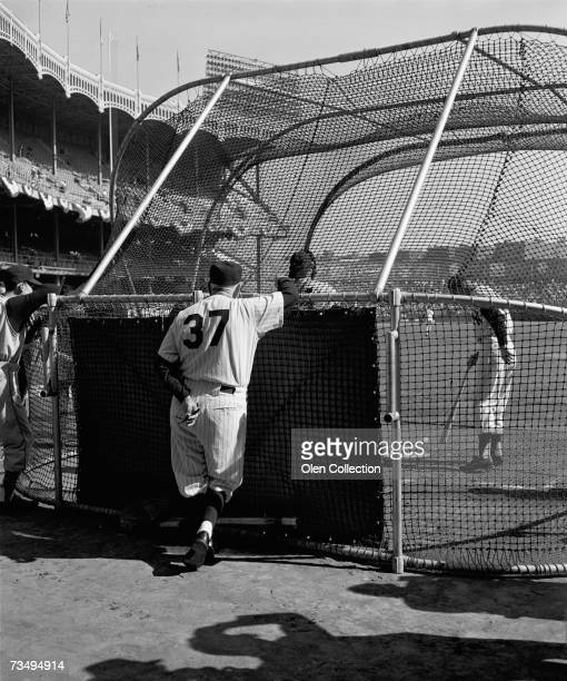 Manager Casey Stengel of the New York Yankees watches batting practice at the batting cage prior to game three of the World Series on October 8 1960...