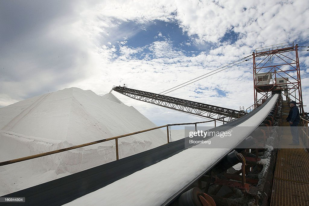 Manager Cesar Martinez inspects salt being stacked at the Exportadora de Sal (ESSA) salt-transshipment facility on Cedros Island off the coast of Guerrero Negro, Mexico, on Wednesday, Jan. 24. 2013. Exportadora de Sal (ESSA), a joint venture between Fidecomiso Mining Development Corporation and Mitsubishi, is one of the leading producers and suppliers of salt for the chlorine-alkali industry in the Pacific Rim. Photographer: Susana Gonzalez/Bloomberg via Getty Images