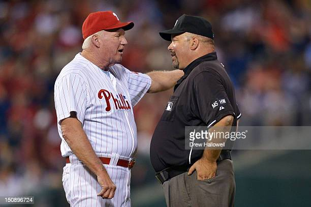 Manager Charlie Manuel of the Philadelphia Phillies argues a call with umpire Wally Bell during the game against the New York Mets at Citizens Bank...