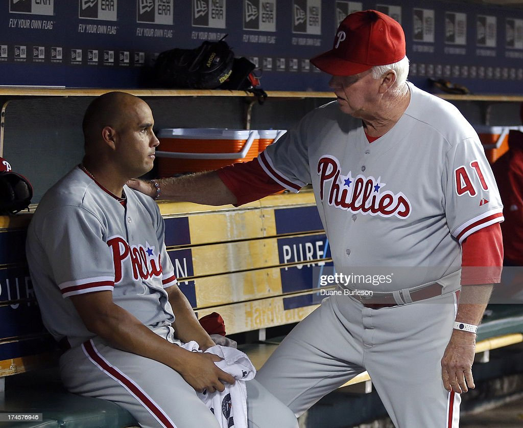 Manager <a gi-track='captionPersonalityLinkClicked' href=/galleries/search?phrase=Charlie+Manuel&family=editorial&specificpeople=217967 ng-click='$event.stopPropagation()'>Charlie Manuel</a> of the Philadelphia Phillies consoles pitcher Raul Valdes #46 after he was pulled with the Detroit Tigers leading 9-0 in the fourth inning at Comerica Park on July 27, 2013 in Detroit, Michigan.