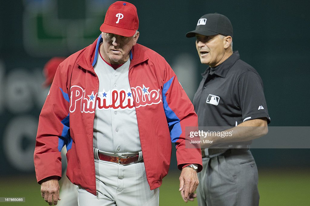 Manager <a gi-track='captionPersonalityLinkClicked' href=/galleries/search?phrase=Charlie+Manuel&family=editorial&specificpeople=217967 ng-click='$event.stopPropagation()'>Charlie Manuel</a> #41 of the Philadelphia Phillies returns to the dugout after arguing a call with umpire umpire John Hirschbeck #17 during the fourth inning against the Cleveland Indians at Progressive Field on May 1, 2013 in Cleveland, Ohio.