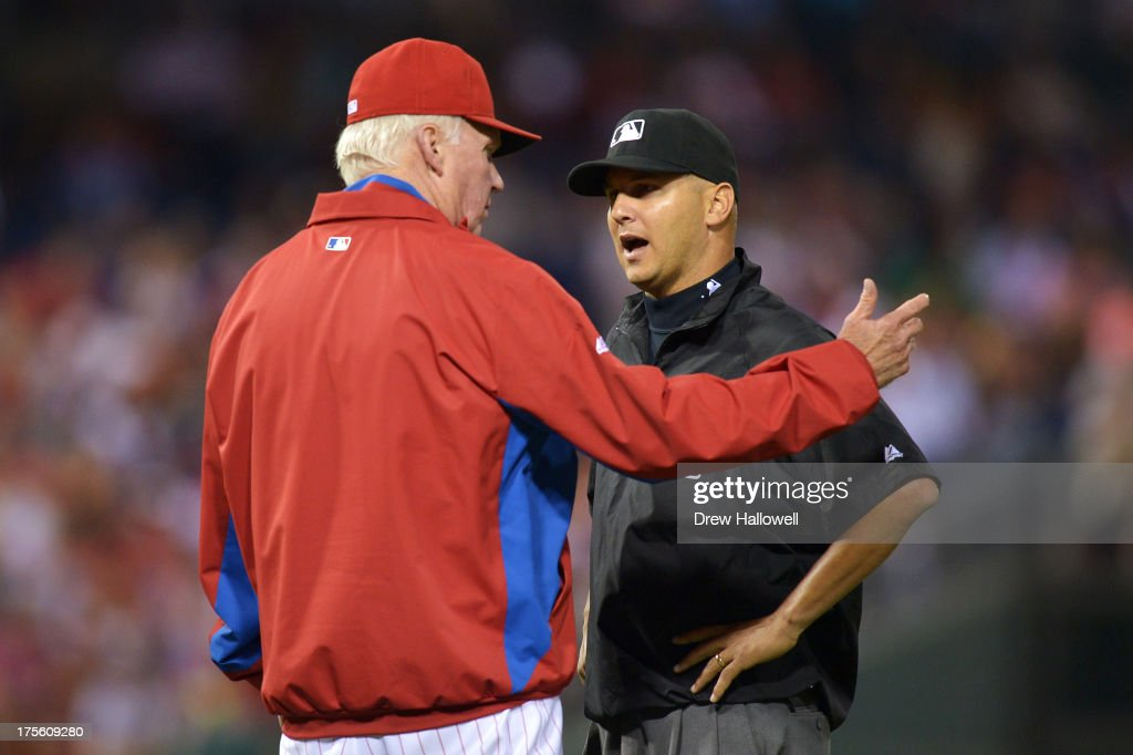 Manager Charlie Manuel #41 of the Philadelphia Phillies talks to umpire Vic Carapazza #85 about a home run that got overturned into a ground rule double by the Atlanta Braves in the fourth inning at Citizens Bank Park on August 4, 2013 in Philadelphia, Pennsylvania.