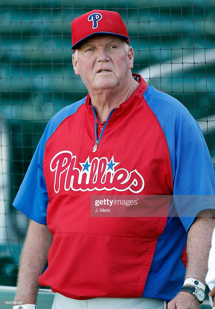 Manager Charlie Manuel #41 of the Philadelphia Phillies watches his team during batting practice just before the start of the Grapefruit League Spring Training Game against the Boston Red Sox at JetBlue Park on March 21, 2013 in Fort Myers, Florida.