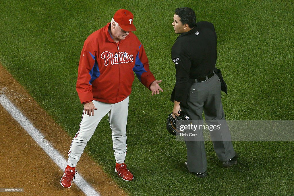Manager <a gi-track='captionPersonalityLinkClicked' href=/galleries/search?phrase=Charlie+Manuel&family=editorial&specificpeople=217967 ng-click='$event.stopPropagation()'>Charlie Manuel</a> talks with home plate umpire Manny Gonzalez during the fifth inning against the Washington Nationals at Nationals Park on October 2, 2012 in Washington, DC.