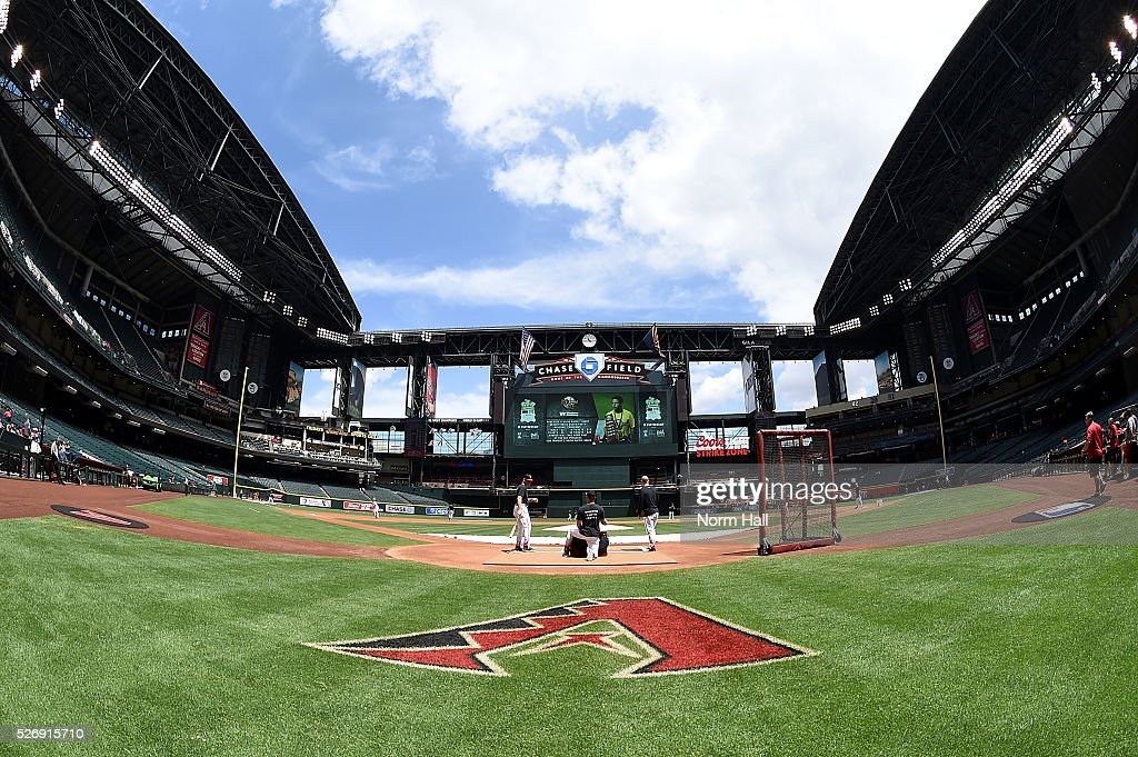 Manager Chip Hale #3 (right) and third base coach Matt Williams #9 of the Arizona Diamondbacks hit ground balls during early infield practice prior to a game against the Colorado Rockies at Chase Field on May 01, 2016 in Phoenix, Arizona.