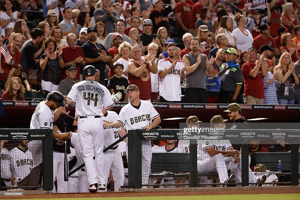 Manager Chip Hale #3 of the Arizona Diamondbacks congratulates <a gi-track='captionPersonalityLinkClicked' href=/galleries/search?phrase=Paul+Goldschmidt&family=editorial&specificpeople=7511120 ng-click='$event.stopPropagation()'>Paul Goldschmidt</a> #44 after Goldschmidt hit a solo home run against the Houston Astros during the first inning of the MLB game at Chase Field on May 30, 2016 in Phoenix, Arizona.