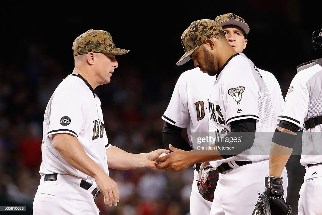 Manager Chip Hale #3 of the Arizona Diamondbacks removes starting pitcher Edwin Escobar #43 during the fourth inning of the MLB game against the Houston Astros at Chase Field on May 30, 2016 in Phoenix, Arizona.