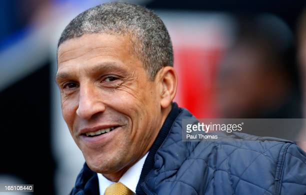 Manager Chris Hughton of Norwich smiles before the Premier League match between Wigan Athletic and Norwich City at the DW Stadium on March 30 2013 in...