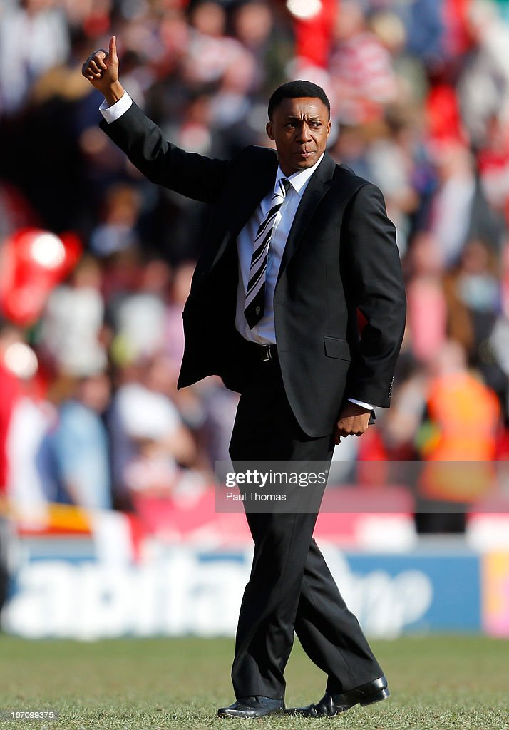 Manager Chris Kiwomya of Notts County gestures towards the travelling fans at full time of the npower League One match between Doncaster Rovers and Notts County at the Keepmoat Stadium on April 20, 2013 in Doncaster, England.