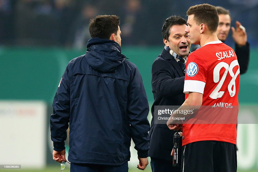 Manager Christian Heidel (C) celebrates with <a gi-track='captionPersonalityLinkClicked' href=/galleries/search?phrase=Adam+Szalai&family=editorial&specificpeople=2344504 ng-click='$event.stopPropagation()'>Adam Szalai</a> of Mainz after the DFB cup round of sixteen match between FC Schalke 04 and FSV Mainz 05 at Veltins-Arena on December 18, 2012 in Gelsenkirchen, Germany. The match between Schalke and Mainz ended 1-2.