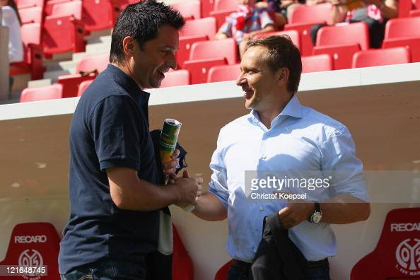 Manager Christian heidel of Mainz and manager Horst Heldt shake hands prior to the Bundesliga match between FSV Mainz 05 and FC Schalke 04 at Coface...