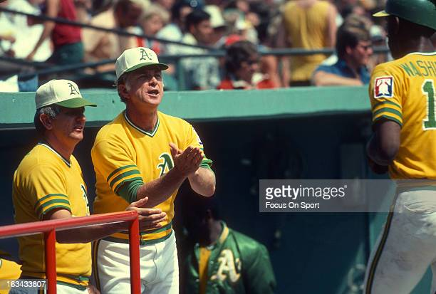 Manager Chuck Tanner of the Oakland Athletics congratulates Claudell Washington after he scored against the Minnesota Twins during an Major League...