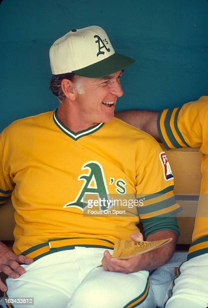 Manager Chuck Tanner of the Oakland Athletics laughing in the dugout before the start of an Major League Baseball game against the Minnesota Twins...