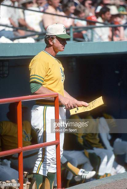 Manager Chuck Tanner of the Oakland Athletics looks on from the steps of the dugout during an Major League Baseball game against the Minnesota Twins...