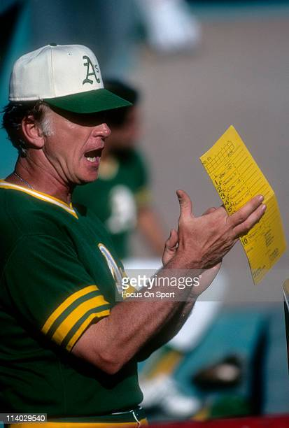 Manager Chuck Tanner of the Oakland Athletics watches the action from the dugout during a Major League Baseball game against the Minnesota Twins...