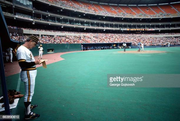 Manager Chuck Tanner of the Pittsburgh Pirates looks at the lineup card as he stands in front of the dugout during a Major League Baseball game at...