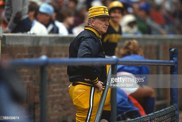 Manager Chuck Tanner of the Pittsburgh Pirates looks on from the steps of the dugout during an Major League Baseball game against the Chicago Cubs...