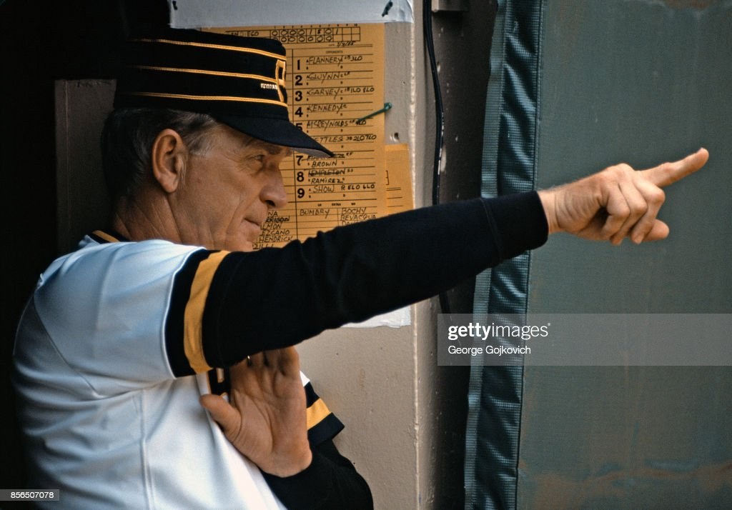 Manager Chuck Tanner of the Pittsburgh Pirates signals from the dugout during a Major League Baseball game against the San Diego Padres at Three Rivers Stadium on July 4, 1985 in Pittsburgh, Pennsylvania.